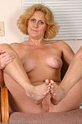 Blonde MILF plays with her feet and her pussy just for us from All Over 30
