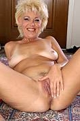 Elegant blonde MILF spreads her legs wide for us all from All Over 30
