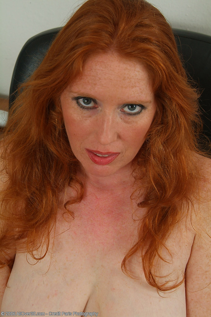 Redheaded mature mom plays with her nipples and pussy 7