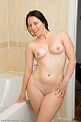 Bald pussy Amber in the bubble bath from All Over 30