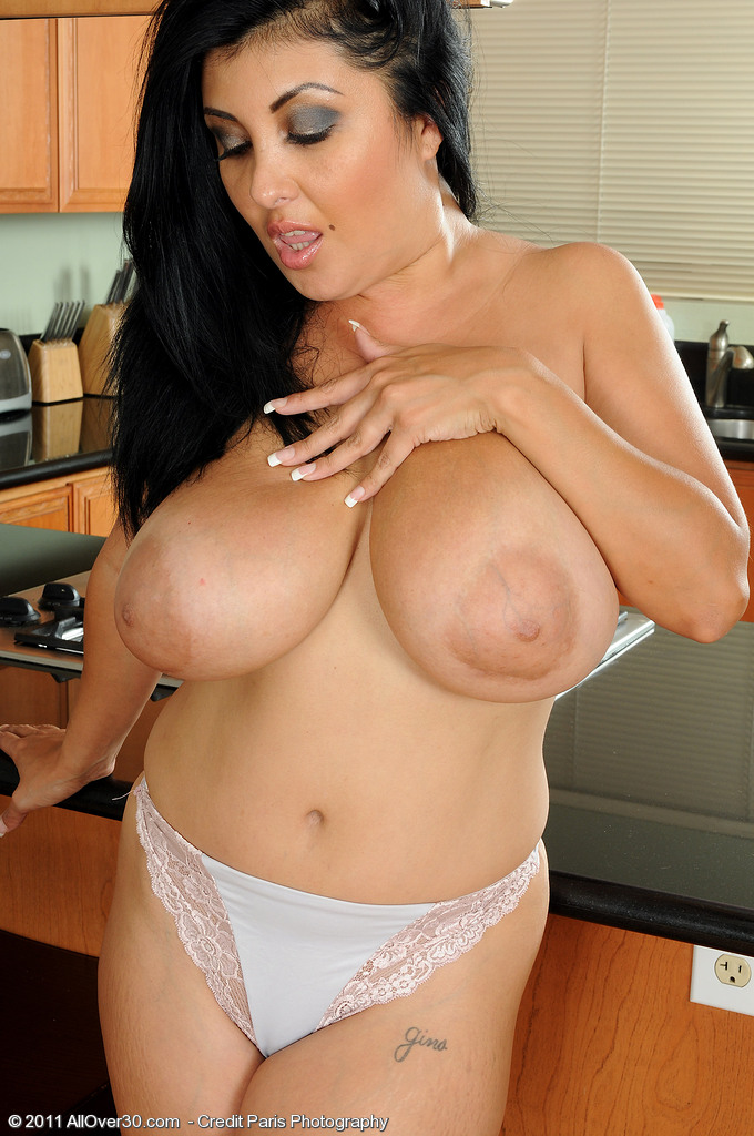 Busty Brenda of All Over 30 gets nude in her kitchen