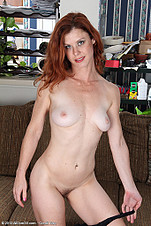 Redheaded Jessica Adams slips a large dildo deep from All Over 30