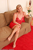 57 year old Lena in sexy red lingerie spreads her legs from All Over 30