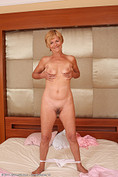 Lili shows off her furry 56 year old pussy and ass from All Over 30