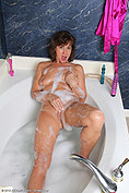 Saggy boobs Lynn blows bubble in the bath from All Over 30