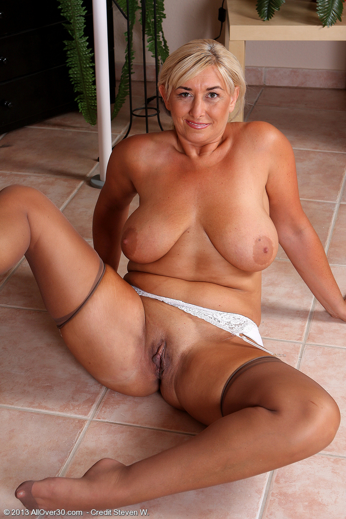 image Posh pierced granny in stockings fucks