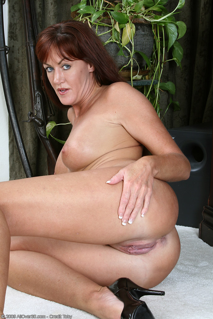 Phat Pussy Redhead Mom Shows Off Her Bang Ables From All Over