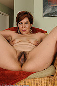 Elegant redheaded Veronica Devil spreads her moist pussy from All Over 30