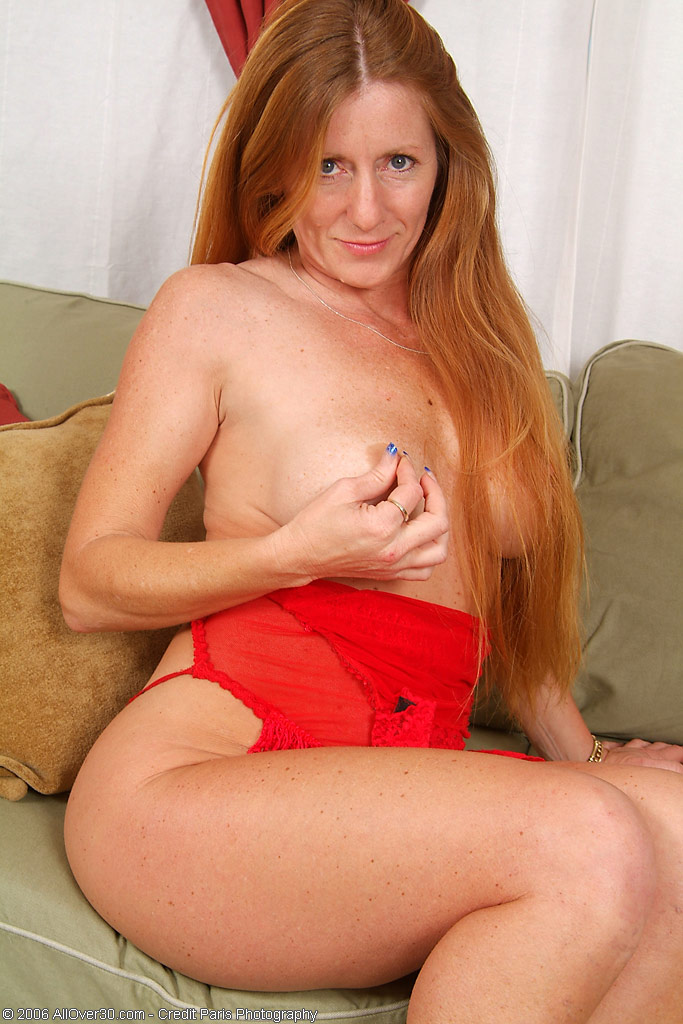Redhead milf on couch